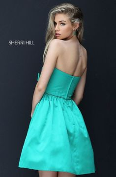Sherri Hill has the most flattering and fashionable cocktail dresses to spice up your next party! Style 50547 available at WhatchamaCallit Boutique.