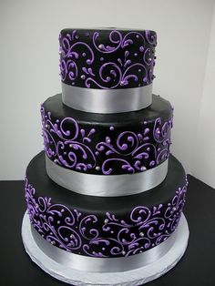 Change the black out for dark red and make the swirls a darker purple. Change silver ribbon for rose gold colored.   Aaaaand make it a 2 or a 1 tier.