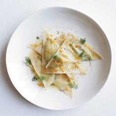 Goat Cheese Ravioli with Orange & Fennel by Mario Batali, foodandwine:Using wonton wrappers is a great shortcut for making these tangy herbed goat cheese ravioli.