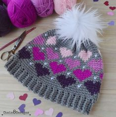 This cute beanie pattern is full of love and hearts. Great for Valentine's Day or anyday. Make this FREE crochet pattern in a soft, squishy yarn today! Crochet Gifts, Free Crochet, Knit Crochet, Crochet Dolls, Crochet Hat For Women, Crochet Woman, Knitting Patterns, Crochet Patterns, Crochet Designs