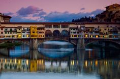 The Ponte Vecchio, medieval bridge over the Arno River, Florence. During World War II the bridge was not destroyed by the Nazis -- unlike many other bridges in Europe -- under an express order from Adolf Hitler. The River, Florence Tuscany, Tuscany Italy, Beautiful Places To Visit, Oh The Places You'll Go, San Diego, Italy Travel, Travel Photography, Around The Worlds