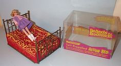 """""""Bedknobs and Broomsticks"""": The Dizzy Girl head mold by Mego was used for Eglantine, but the doll is only marked """"Hong Kong"""" on her back with no other reference to Mego. She was sold separately. Through a company called Hoffman Toys, you could purchase the magical bed, which was a motorized """"bump-and-go"""" toy that worked with two """"C"""" batteries."""