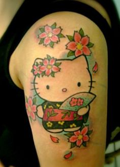 Hello Kitty, surrounded by sakura. Part of my planned Asian-inspired half-sleeve.