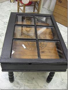 DIY old window converted into a coffee table! Or buy one at a yard sale like we did for mom.