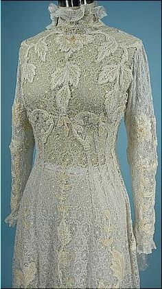Circa 1908 All Lace Trained Gown with Wool Inserts. Princess shape, all spider lace gown with high frilly lace neck and train. The inserts are a woven ecru wool. (Detail)