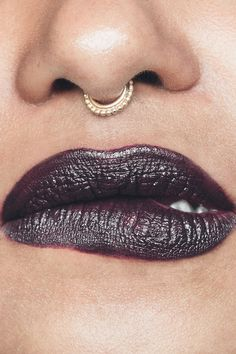 When burgundy is too predictable and black is too much, reach for this deep, bruised plum, as seen on Michele.