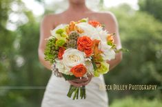 gorgeous bouquet. It incorporates the greens, orange and whites that I envision. Would a hint of bright yellow or pale blue fit with this?