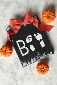 25 Fall Handprint Crafts Youll Treasure Forever Make an adorable baby keepsake with this BOO baby footprint craft. The post 25 Fall Handprint Crafts Youll Treasure Forever appeared first on Halloween Crafts. Diy Halloween, Premier Halloween, Halloween Arts And Crafts, Baby First Halloween, Hallowen Costume, Theme Halloween, Halloween Crafts For Kids, Fall Crafts For Toddlers, Infant Halloween