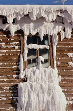 A window of a house coated in frost and snow during the winter in Yakutsk. Yakutia, Siberia, Russia.