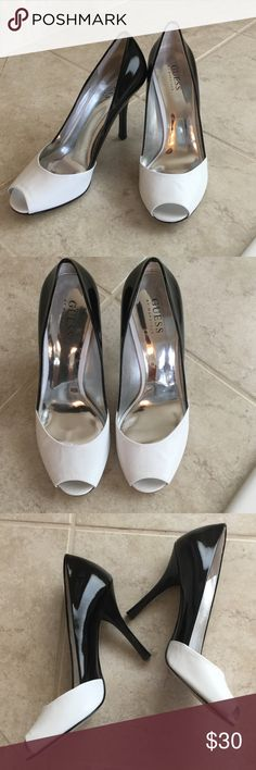 Guess Heels Guess by Marciano black and white heels, peep toe. Size 8 worn a few times to try on. It great condition. I believe they are a 3 inch heel. Guess by Marciano Shoes Heels