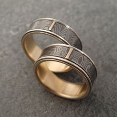 """""""wood"""" silver rings!   """"For this wedding set I have inlaid each ring with a ribbon of mokume gane. Mokume gane is a term which means """"woodgrain metal"""". It is an ancient Japanese metallurgy technique where sheets of different types of metal are combined in alternating layers and then fused together."""""""