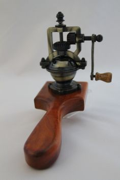 "This peppermill has an antique-style peppermill mechanism that adjusts easily from coarse to extra fine. The metal has a brass finish. The body of the mill is Amboyna from Southeast Asia. The grain is dominant in this piece. It is machine shaped, sanded & a multi-layer durable finish is hand applied.  A card with instructions for the care of wood with the name of the wood and its origin is included with the purchase. Approx. measurements: 7.25""L x 2.75"" tapering to 1.5""W x 5.25""H. #9801"