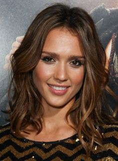 Jessica Alba's wavy bob is ultra-sophisticated and so easy to do. Steal her style:    1. Part damp hair down the middle. Apply curl enhancing cream and let it air dry to bring out your natural waves.   2. If your hair is naturally straight or you just want to touch up your waves, wrap sections of hair around a 2-inch curling and finger comb through to loosen them.  3. Put a dab of styling wax on your fingertips and piece out the ends of your tousled bob to give it more body.