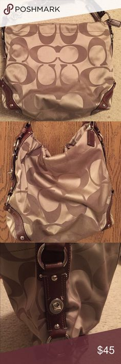 BEAUTIFUL Gently used COACH signature bag BEAUTIFUL Gently used COACH signature bag. Tan bag with classic signature C design. Leather accents and leather strap. Coral lining inside. Zipper pocket with two additional pockets inside bag. Coach Bags Shoulder Bags