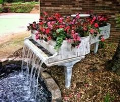 A staffer at an Atlanta piano company took home an old piano that was sadly beyond repair (insect damage). It's now serving as a planter while pumping out 2000 gallons of water/hr as a fountain! by claudette