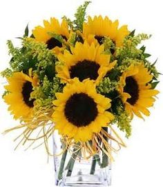 Beautiful vase of sunflowers elegantly designed to cheer their day. When you're blue, bring the sunshine in with sunflowers!