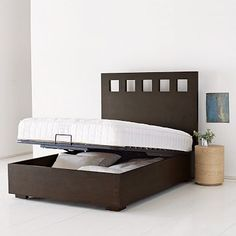 While the Pivot Storage Bed Frame by WestElm is no longer available, I love the concept. Poor husband. Now I have another project for him to start.