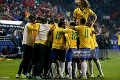 Players of Brazil celebrate a goal scored by their teammate Douglas Costa during the 2015 Copa America Chile Group C match between Brazil and Peru at Municipal Bicentenario Germán Becker Stadium on June 14, 2015 in Temuco, Chile.