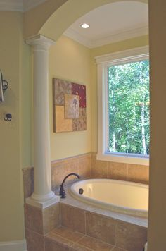 Lovely tub in the master bath.   Country House Plan # 461209.