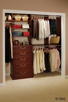 (in small master custom closet)- traditional style dresser drawers with art work above it.