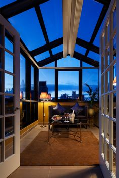 Atrium terrace from Hotel Plaza Athenee with NYC view... Scott Pearson Naples, FL