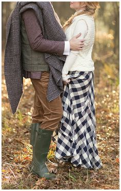 Autumn wedding inspiration: Groom in wellies and tweed and bride in a plaid skirt and sweater. Image by Shauna Veasey Photography.
