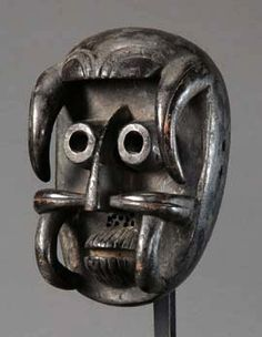 Africa   Face mask from the Kran people of the Ivory Coast   Wood, blackish brown patina