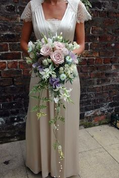 wild white cascading bouquet  | Cascading rose and garden flower bouquet from http://www.petalandtwig ...