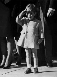 3 year old John F Kennedy, Jr. salutes his father's coffin at St. Matthew's cathedral.
