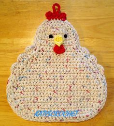 Handmade funky chicken potholder, hand crocheted by me. Potholder is brand-new, never used. Measures 8 x 9 1/2 and is made from 100% cotton yarn. Almost too cute to use, but dont be afraid - it is double thick. Can also be hung on the wall by the little loop at the top of the red comb on her head. Get a whole flock!  NOTE: You may find similar potholders available on Etsy for less, but check the description and photos - they are NOT double thick as mine are. You are VERY likely to burn ...