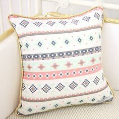 A girly tribal/aztec print on a pillow cover - perfect to throw on a glider in the nursery