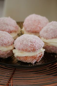 A classic fave... these Raspberry & Cream Jelly Cakes are bites of buttery vanilla cake filled with whipped cream and coated in raspberry jelly and coconut.