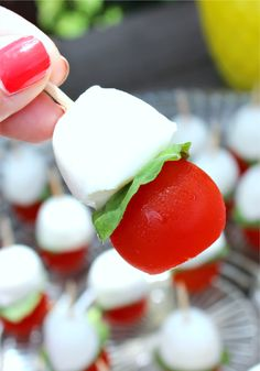 Sometimes the best appetizers are the simple ones. These easy caprese appetizer bites combine the light taste of fresh mozzarella with the juiciness of cherry tomatoes and the slight spice of basil. Set these elegant finger foods out on a simple glass dish for a colorful appetizer that your guests won't be able to resist.
