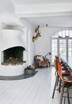 Charming and elegant dining room with a fireplace that is a copy of a fireplace at the Open Air Museum in Kgs. Lyngby, Denmark called 'The Cod Mouth'.