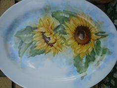Fernanda Cantoni -  girasoli su piatto ovale di porcellana dipinto a mano.
