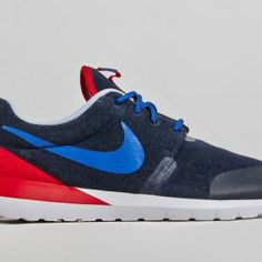 """Presenting the new """"France"""" version of the Nike Roshe Run NM SP, which features a navy upper paired with a red heel tab, blue Swoosh and white accents all over. Clean and sleek, you can order yours now via SlamJam Socialism."""