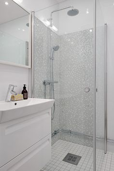 scandinavian apartment bathroom shower misaic tiles