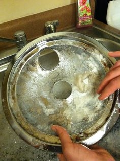 How to clean a drip pan from an electric stove top.  1.) soak drip pans. 2.) Cover pans with a generous amount of sugar. 3) start scrubbing! The sugar works as an abrasive to get that cooked on grease off. Repeat steps as needed. Easy cheap way to clean without using harsh chemicals!