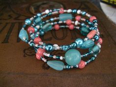 Coral and Mint Turquoise Beaded Memory Wire Bracelet Multi Strand Wrapped Bracelet  This 4 loop memory wire bracelet creates a multi-strand layered