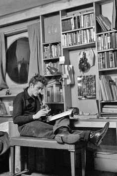 James Dean reading music while playing the recorder.