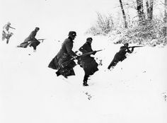 WWII - German Pionier-Stostruppen (combat engineer shock troops) engage in combat with an enemy in the snow. February 2, 1940