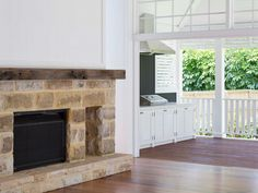 Stritt Design & Construction | Avalon Village Residence. Hamptons style. Sandstone fireplace with timber mantel.