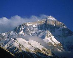 'Warriors of the snow mountain': Mount Everest as seen from the Rongbuk Monastery in Tibet, China. photo by Galen Rowel Mysterious Places On Earth, Places Around The World, Around The Worlds, Monte Everest, Haunting Stories, Himalaya, Snow Mountain, Tornados, Great Photographers