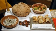 Common Medieval food--picked herrings, fried fig pastries, leeks and sops, wheat or barley bread, nuts