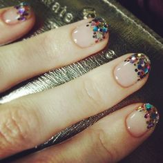 "This style of applying French tip multi color gems is called wearing ""Junk Nails"". When you go to the salon you tell them you want ""Junk Nails""."