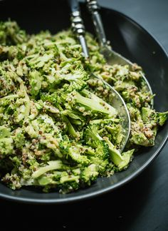 Healthy broccoli slaw recipe with quinoa, toasted almonds and basil tossed in a tangy honey-mustard dressing (no mayo)! This slaw will be a hit at potlucks.