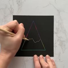 Looking for ideas for your scratch art drawings? Why not try creating a simple geometric design like this one! The beauty of this triangular landscape lies in its simplicity, and it would be easy to c Disney Doodles, Paper Drawing, Paper Art, Kratz Kunst, Simple Geometric Designs, Scratchboard Art, Scratch Art, Galaxy Art, Easy Drawings