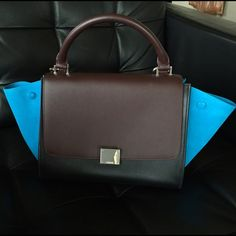 """Celine trapeze tricolor black burgundy turquoise 100% AUTHENTIC Like new (worn 3 times) Celine trapeze mini (base: 11"""" x 6, height ~9"""", width at widest point of the wings ~17""""). It's a normal sized bag, """"mini"""" because it's the smallest of the 3 sizes they make. Bought Feb 2014 but I've only used it 3 times so it's got to go. BEAUTIFUL black leather body, with turquoise suede """"wings"""" (which can be tucked in) and burgundy flap, handle and detachable strap. Silver hardware. I paid $2956 with…"""