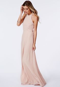 Nothing says summer like a gloriously pretty maxi dress, and this nude chiffon piece is ideal. The backless design and cute strappy detailing on the neck are perfect for gliding along in this season. Style with platforms and plenty of accessories for a look that's fit for any occasion.