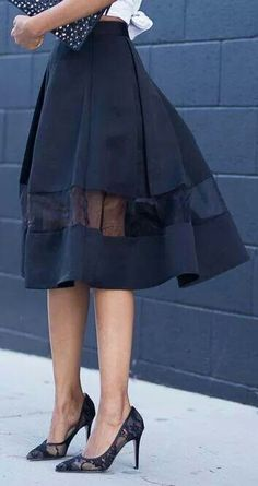 This could be the best way to rock a midi skirt when short -- with some see-through panelling around the knee, worn high with top tucked in or knotted up, and always worn with heels!